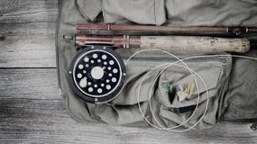 Old trout fishing gear on top of fishing vest Stock Photography