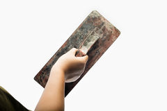 Old trowel in  hand Stock Photo