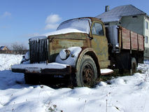 Old Truck. Covered with snow stands abandoned near the road Stock Images