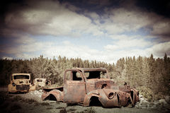 Old truck. Aged photo of two trucks abandoned somewhere in Canada Stock Photography