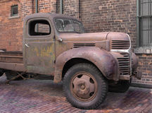 Old truck in brick alley. Royalty Free Stock Photo