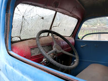 Old truck cab. In with broken windshield and some dust inside Royalty Free Stock Photos