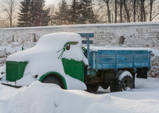 Old truck covered with snow Stock Photos