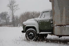 Old truck covered with snow in the woods Royalty Free Stock Image