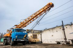 Old truck crane. Standing near construcrion site Royalty Free Stock Images