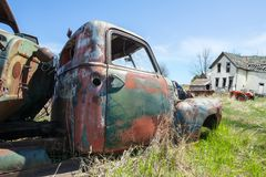 Old Truck, Dairy Farm, Rural Country Scene. Rural country scene of an old Wisconsin dairy farm. A vintage classic antique truck sits and rusts in the yard stock photo
