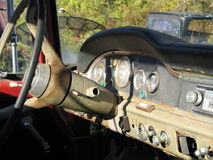 Old Truck Dashboard. The dashboard of an old rusty truck sitting in a junkyard Royalty Free Stock Photography