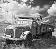 Old truck on field stock photography