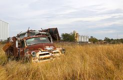 Old Truck Filled with Junk. Old truck sitting in a hedge row collecting junk Stock Photos