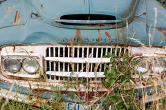 Old truck in grass stock photo