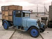 Old truck with load in Amsterdam harbor stock photography