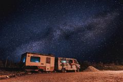 An old truck with milky way in a wasted territory on the outskirts of a small town stock images