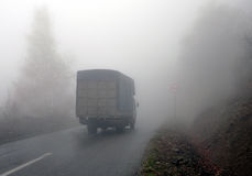 Old Truck moving through fog stock photography