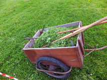 Old truck with mown grass with a scythe, rake and whetstone Royalty Free Stock Image