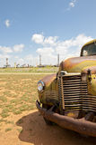 Old truck in oil field. Closeup of an old, abandoned truck in a Texas oil field with oil pumps in the background Stock Image