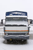 An old truck parked in the snow Stock Images