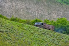 Old truck rises on a mountain slope Royalty Free Stock Photo