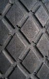 Old truck tire texture. Background texture of used car tire royalty free stock images