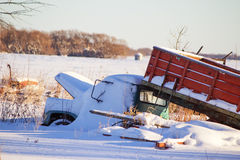 Old truck under snow. Old grain truck with its hood up and the box lifted under snow Royalty Free Stock Images