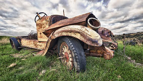 Old truck. A wide angle shot of an old truck found in a field Royalty Free Stock Photos