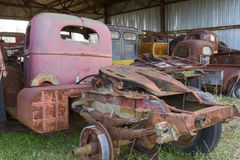 Old trucks in shed Stock Photo