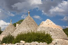 Old trulli of which one collapsed and cloudy sky Stock Photo