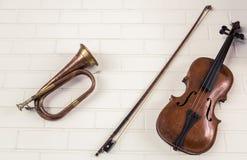 Old trumpet and violin hang Stock Photos