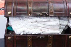 Old trunk with a  knitted clothes things Stock Images