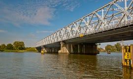 An old truss bridge over a Dutch river royalty free stock photos