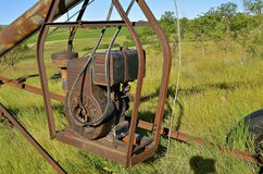 Old tube grain elevator powered by gas engine Stock Image