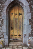 Old tudor wooden oak door wih latches and locks Stock Images