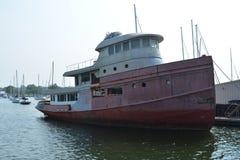 Old tug boat. Moored at marina on sunny day stock photography