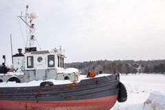 Old Tug Boat in Winter with Copy Space Royalty Free Stock Photos