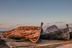 Old tuna boats and the mountain royalty free stock photo