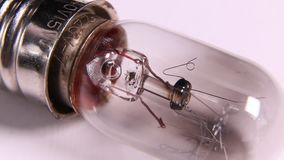 Old tungsten bulb with filament. Macro shot of a classic tungsten bulb and filament stock video