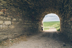 Old tunnel of the old castle. With light in the end Stock Images