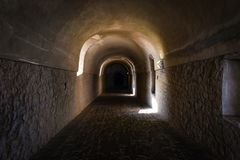 Old tunnel of stone and concrete with windows sunlight in castle stock photos