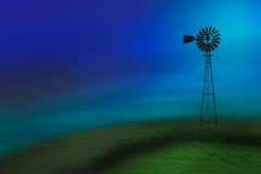 Old turbine. In a field with a blue sky Stock Image
