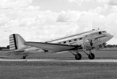 Old turboprop. Vintage silver colored turboprop airplane side view Stock Photography