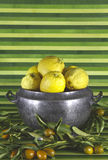 Old tureen with lemons,mandarins,green background Royalty Free Stock Image