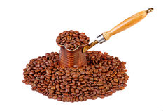 Old turkish copper coffee pot full of coffee beans. And cofee beans on white background Royalty Free Stock Photos