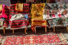 Old Turkish rugs and carpets for sale, vintage shop in Cukur Cuma Caddesi district, Istanbul royalty free stock image