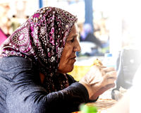 Old turkish woman is eating Royalty Free Stock Images