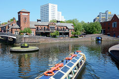 Old turn junction, Birmingham. View of The Malt House pub at Old Turn Junction with a tour boat in the foreground, Birmingham, England, UK, Western Europe Royalty Free Stock Images