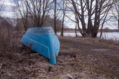 Old boat ashore. The old turned boat in the fishing village Royalty Free Stock Photography