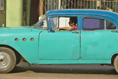 1955 old turquoise Buick driving through the streets of Havana, Cuba Royalty Free Stock Image