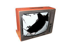 Old tv. Old trashed TV with a smashed screen Stock Images