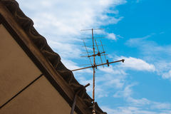 Old TV antenna on the roof Stock Images