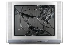 Old TV with broken screen. Isolated in studio stock images