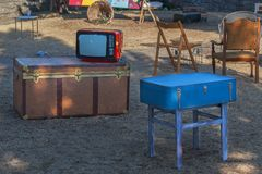 Old TV, chest and suitcase. Old TV, chest, suitcase and various furniture on the street Royalty Free Stock Image